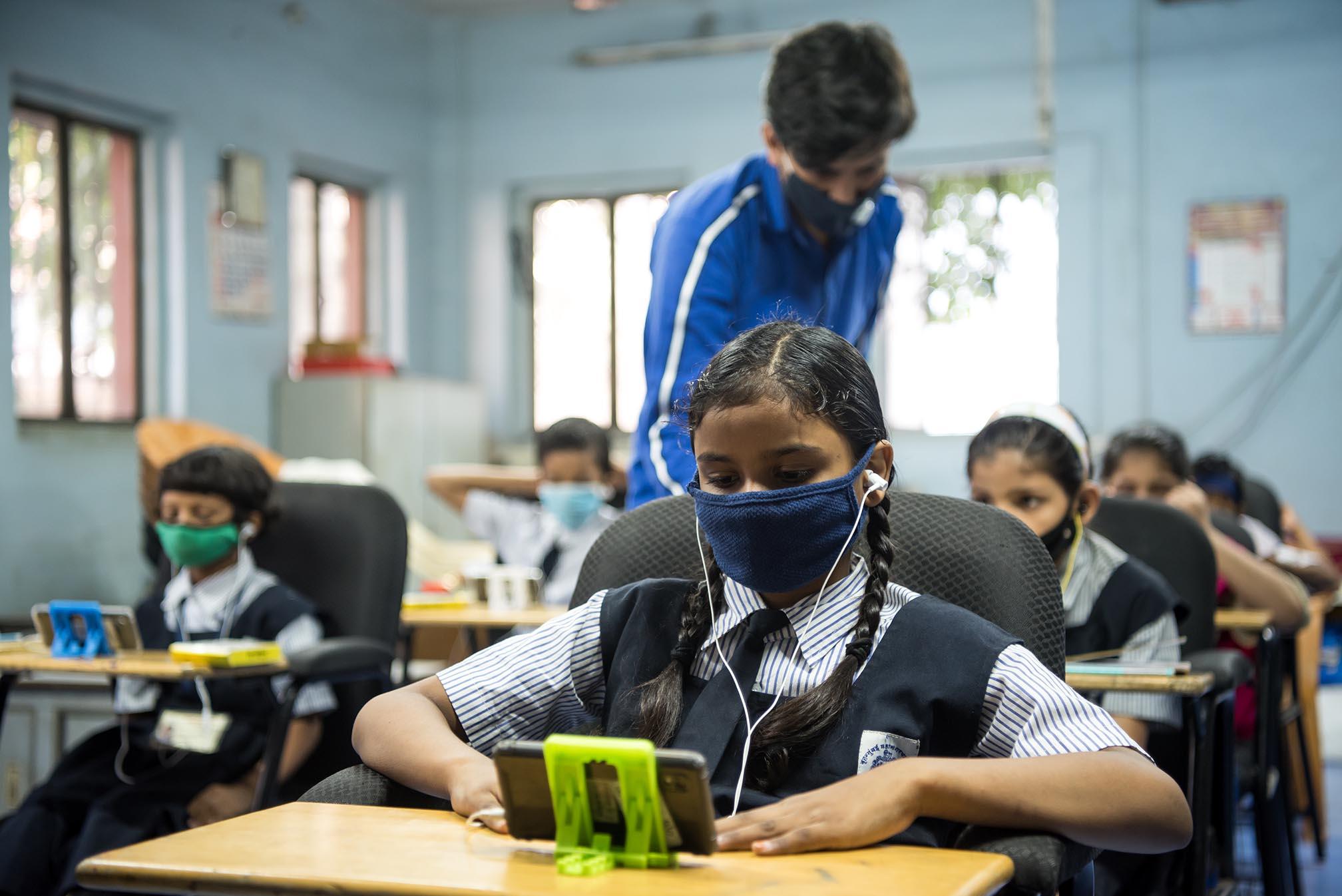 Children studying through content on smartphones